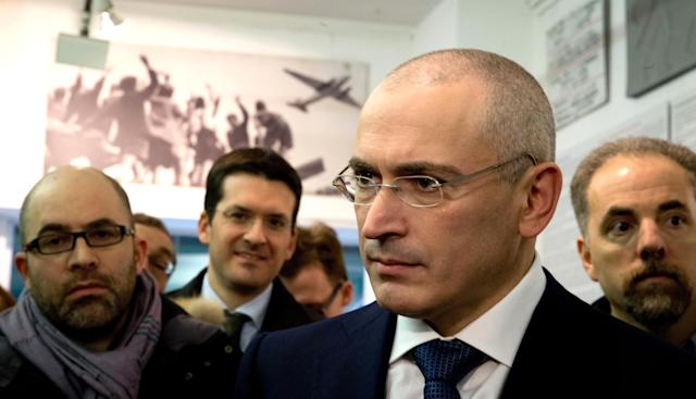 CORRECTS NAME OF MUSEUM -Mikhail Khodorkovsky,front right arrives for a press conference at the Wall Museum, Haus am Checkpoint Charlie in Berlin, Sunday Dec. 22, 2013. Other persons are not identified. The former oil baron Mikhail Khodorkovsky was reunited with his family in Berlin on Saturday, a day after being released from a decade-long imprisonment in Russia. Khodorkovsky, a prominent critic of Russian President Vladimir Putin, was meeting with his eldest son Pavel and his parents, Marina and Boris, who had flown separately to the German capital to meet him (AP Photo/dpa, Kay Nietfeld)