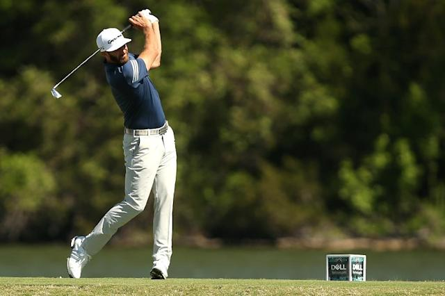Dustin Johnson tees off on the 14th hole of his match during round four of the World Golf Championships Match Play at the Austin Country Club on March 25, 2017 (AFP Photo/Darren Carroll)