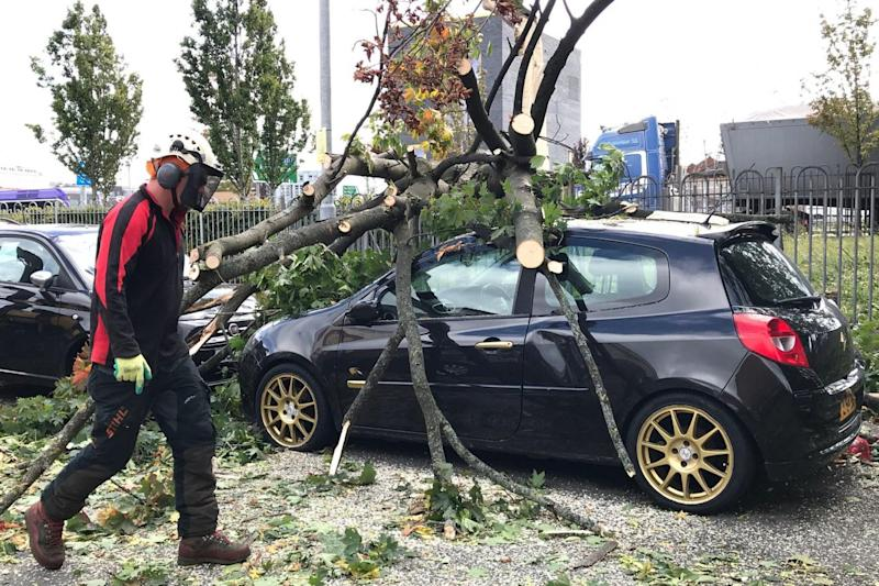 A tree which has fallen onto a car in Belfast as Storm Ali has begun to make itself felt across Northern Ireland and parts of Scotland and England (PA)