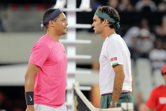 Trevor Noah and Roger Federer face off before the exhibition match held at the Cape Town Stadium in Cape Town, South Africa, Friday Feb. 7, 2020. (AP Photo/Halden Krog)