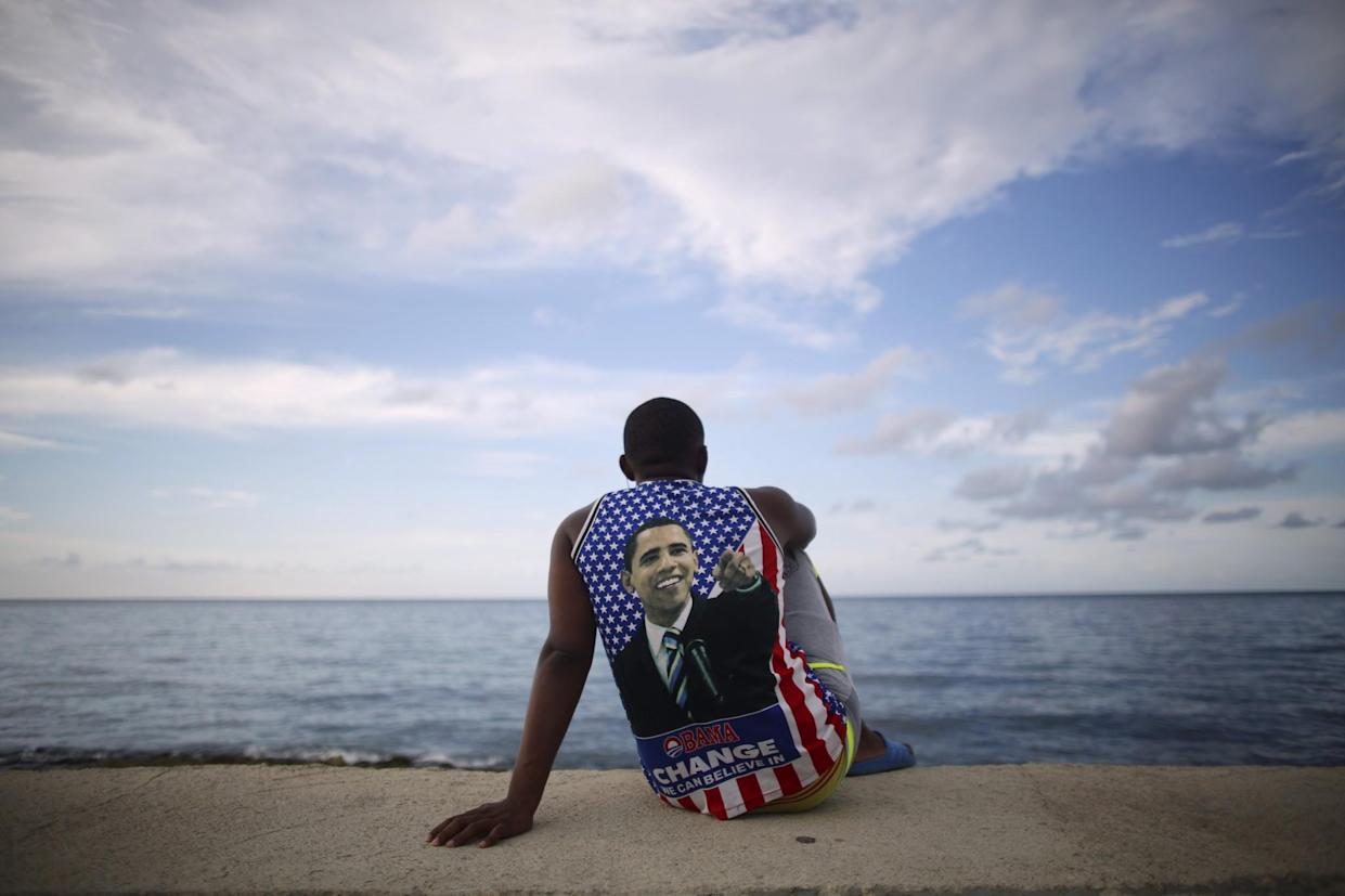 A Cuban fan of President Obama sits near the U.S. Embassy in Havana, Aug. 14, 2015. (Photo: Alexandre Meneghini/Reuters)