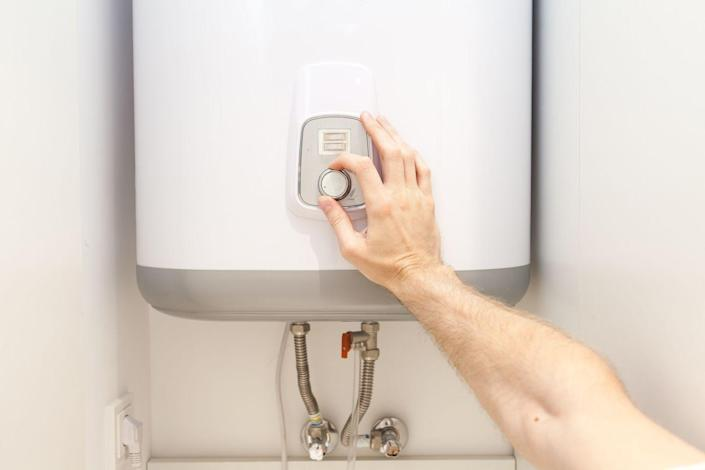 <p>It's not recommended to completely turn off a water heater, but you can a significant amount of energy—and money—while on vacation by switching the water heater to vacation mode. If your heater doesn't have vacation mode, simple lower the temperature several degrees to prevent it from cycling on and off so often.</p>