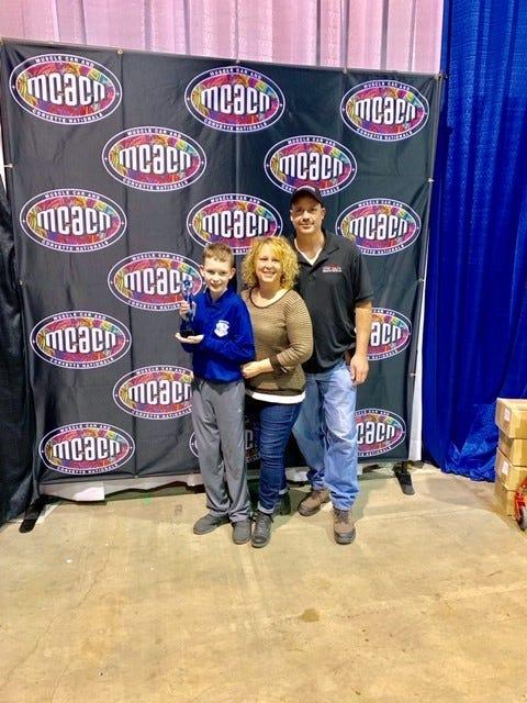 Hillary and Roman Sobilo cheer their son, Keegan, at the Muscle Car and Corvette Nationals on Nov. 23, 2019, in Rosemont, Ill.
