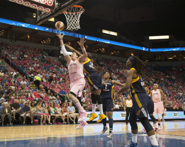 Minnesota Lynx center Janel McCarville (4) shoots against Indiana Fever forward Tamika Catchings (24) during the first half of a WNBA basketball game on Saturday, Aug. 24, 2013, in Minneapolis. Indiana's Erlana Larkins (2) and Shavonte Zellous (1) also defend on the play. AP Photo/Paul Battaglia)