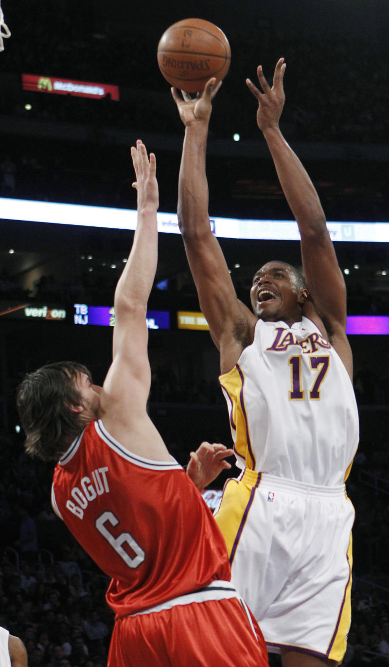 FILE - In this Jan. 10, 2010 file photo, Los Angeles Lakers center Andrew Bynum (17) shoots over Milwaukee Bucks center Andrew Bogut (6) during the first half of an NBA basketball game in Los Angeles. . On Saturday, Feb. 1, 2014, the Pacers added size and scoring punch to their roster by signing mercurial free agent center Andrew Bynum for the rest of the season. Team officials did not release additional details about the contract and said Bynum was expected to join the team sometime next week. (AP Photo/Lori Shepler, File)