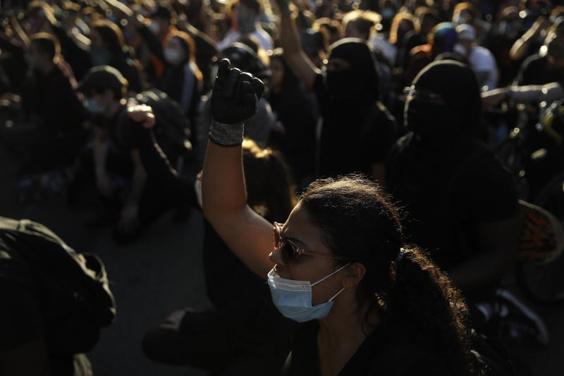 Protesters gather in Philadelphia, Monday, June 1, 2020 during a march calling for justice over the death of George Floyd in Philadelphia, Monday, June 1, 2020. Floyd died after being restrained by Minneapolis police officers on May 25. (AP Photo/Matt Rourke)