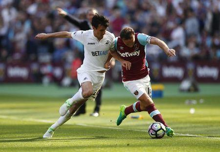Britain Football Soccer - West Ham United v Swansea City - Premier League - London Stadium - 8/4/17 West Ham United's Mark Noble in action with Swansea City's Jack Cork  Reuters / Eddie Keogh Livepic