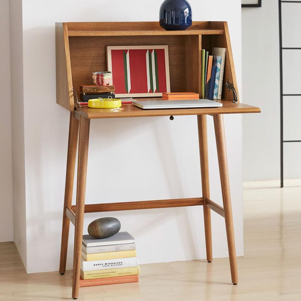 """<h3>West Elm Mid-Century Mini Secretary</h3><br>This streamlined secretary desk comes in a mini size that's the perfect size for small spaces — without sacrificing any MCM-style. <br><br><strong>West Elm</strong> Mid-Century Mini Secretary, $, available at <a href=""""https://go.skimresources.com/?id=30283X879131&url=https%3A%2F%2Fwww.westelm.com%2Fproducts%2Fmid-century-mini-secretary-h2096%2F"""" rel=""""nofollow noopener"""" target=""""_blank"""" data-ylk=""""slk:West Elm"""" class=""""link rapid-noclick-resp"""">West Elm</a>"""
