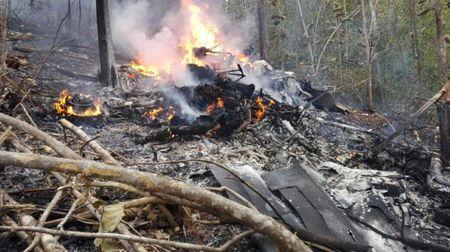 Smoke and fire seen at the site where a plane crashed in the mountainous area of Punta Islita, in the province of Guanacaste, in Costa Rica December 31, 2017 in this picture obtained from social media.  Ministerio de Seguridad Publica de Costa Rica/via REUTERS