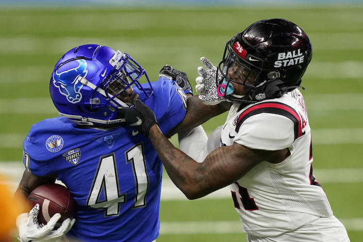 Buffalo wide receiver Antonio Nunn (41) is stopped by Ball State cornerback Antonio Phillips (21) during the first half of the Mid-American Conference championship NCAA college football game, Friday, Dec. 18, 2020 in Detroit. (AP Photo/Carlos Osorio)