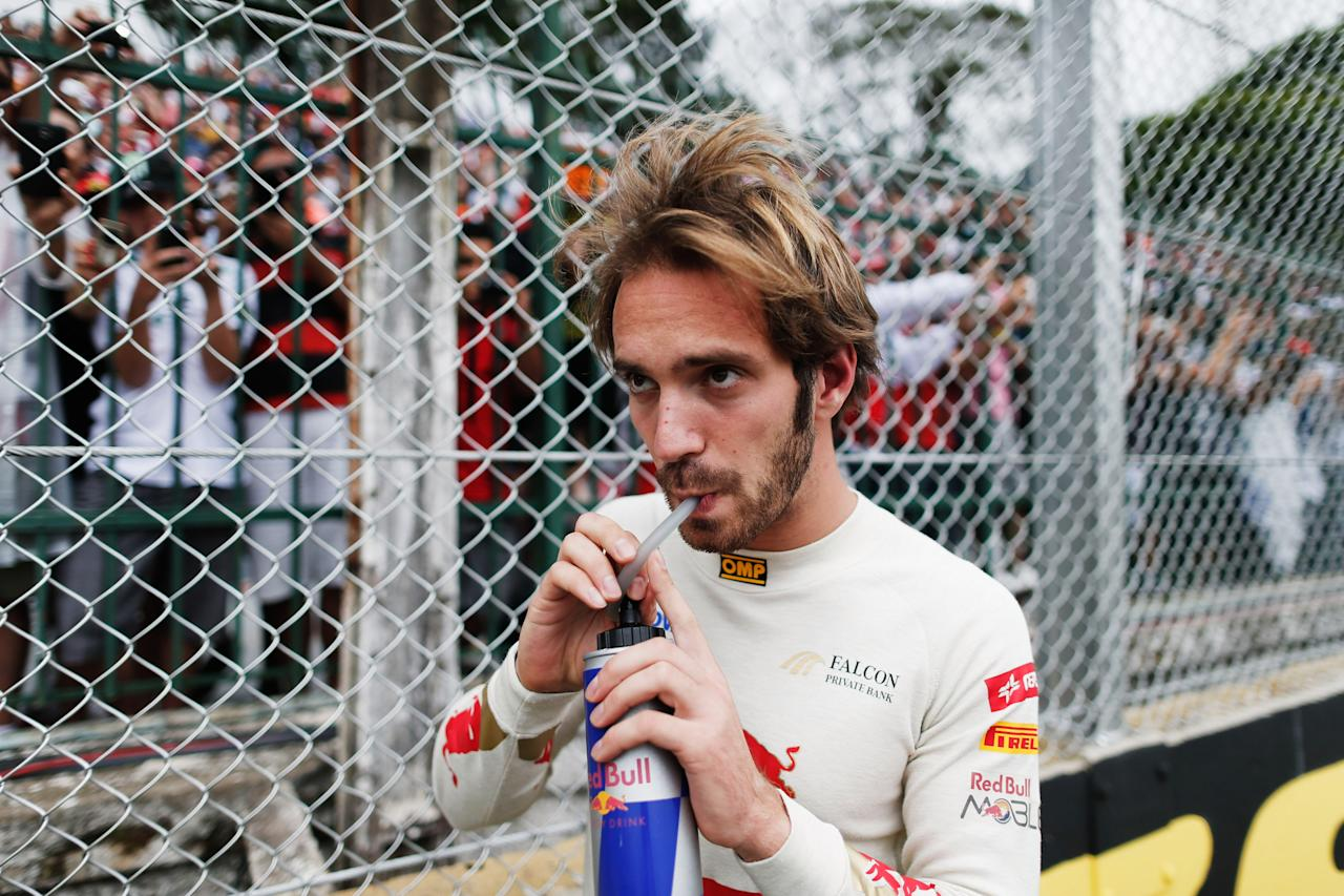 SAO PAULO, BRAZIL - NOVEMBER 25:  Jean-Eric Vergne of France and Scuderia Toro Rosso prepares to drive during the Brazilian Formula One Grand Prix at the Autodromo Jose Carlos Pace on November 25, 2012 in Sao Paulo, Brazil.  (Photo by Peter Fox/Getty Images)