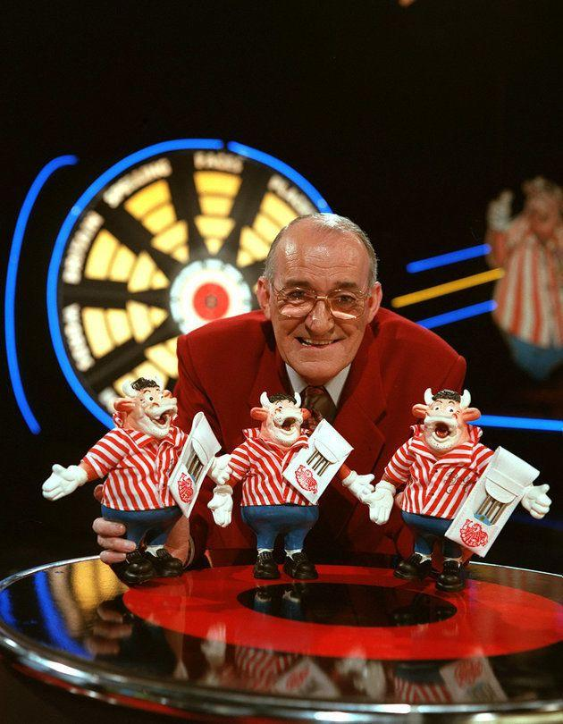 """<strong>Jim Bowen</strong><br /><strong>TV presenter and comedian (b. 1937)</strong><br /><br />Best known for presenting the cult darts-based game show '<a href=""""https://en.wikipedia.org/wiki/Bullseye_(UK_game_show)"""" target=""""_blank"""">Bullseye</a>', the comedian died in March, aged 80havingpreviously suffered difficulties with his health after suffering a stroke in 2016."""