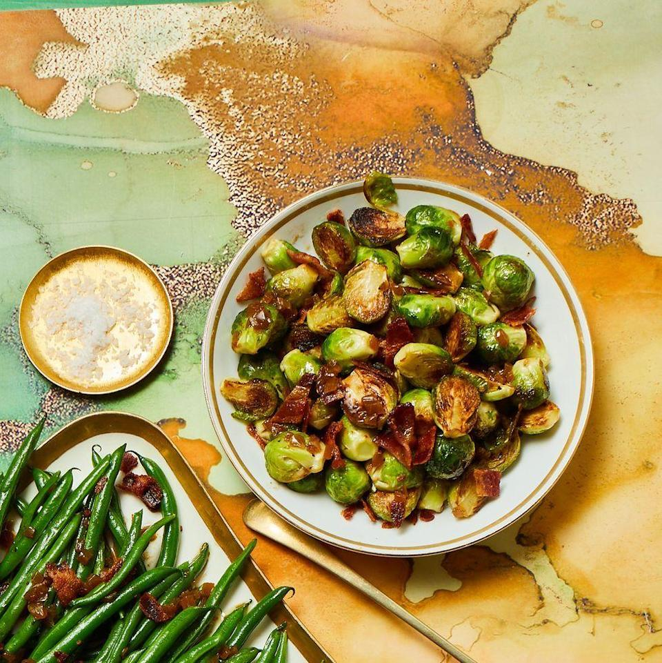 """<p>If your oven's full of the main course, roast your Brussels sprouts in a pan on the stove instead. </p><p><a href=""""https://www.womansday.com/food-recipes/a34131195/pan-roasted-brussels-sprouts-recipe/"""" rel=""""nofollow noopener"""" target=""""_blank"""" data-ylk=""""slk:Get the recipe for Pan Roasted Brussels Sprouts."""" class=""""link rapid-noclick-resp""""><strong><em>Get the recipe for Pan Roasted Brussels Sprouts.</em></strong></a></p>"""