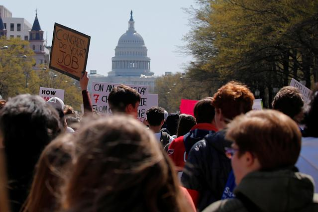 <p>Students march to the U.S. Capitol, as part of a nationwide walk-out of classes to mark the 19th anniversary of the Columbine High School mass shooting, in Washington, D.C., April 20, 2018. (Photo: Brian Snyder/Reuters) </p>