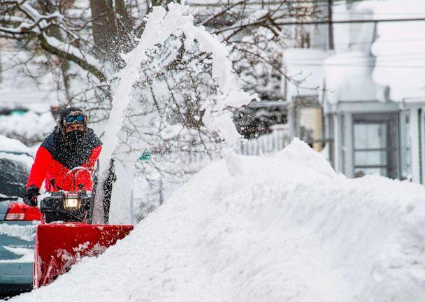PHOTO: A person uses a snowblower to clear snow from the road during winter storm Orlena in Lawrence, Mass., on Feb. 2, 2021. (Afp Contributor#afp/AFP via Getty Images)