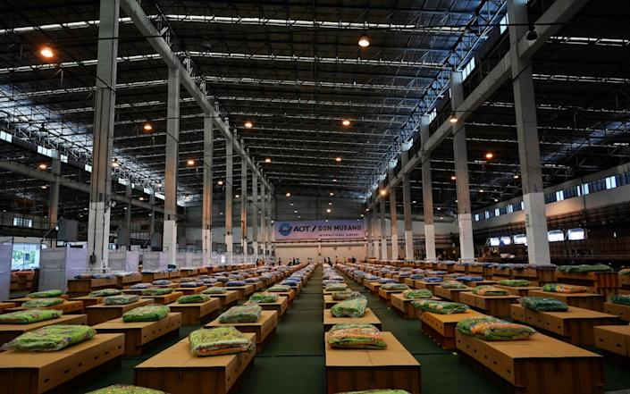 In Bangkok, Thailand, 1,800 cardboard beds are prepared at a Covid-19 field hospital inside a warehouse at the Don Mueang International Airport - LILLIAN SUWANRUMPHA/AFP
