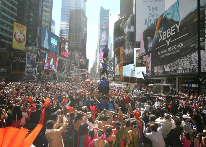 Revelers gather around performers at a previous Diwali at Times Square festival.