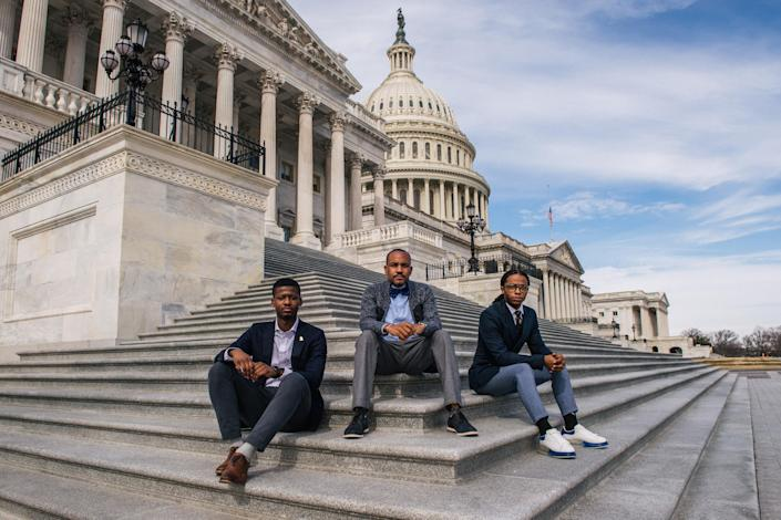 From left: Jabir McKnight, Mike McQuerry, and Remmington Belford, sit on the House steps at the Capitol in Washington, Wednesday, Feb. 17, 2021. (Brandon Bell/The New York Times)