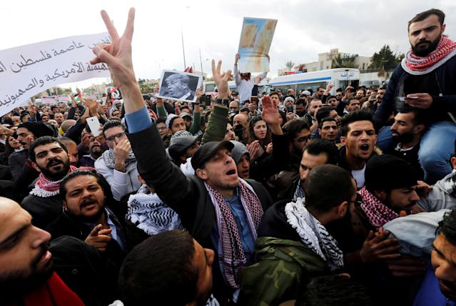<p>Protesters shout slogans during a protest near the American Embassy in Amman, Jordan, Dec. 7, 2017. (Photo: Muhammad Hamed/Reuters) </p>