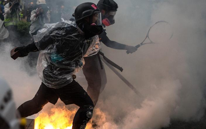Protesters clash with police after an anti-government rally in Hong Kong's Tsuen Wan district - Getty Images AsiaPac
