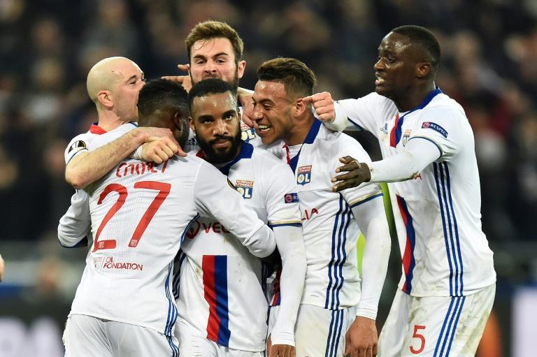 Lyon's French forward Alexandre Lacazette (C) celebrates with teammates after scoring a goal against AS Roma during their UEFA Europa League round of 16 football match on March 9, 2017