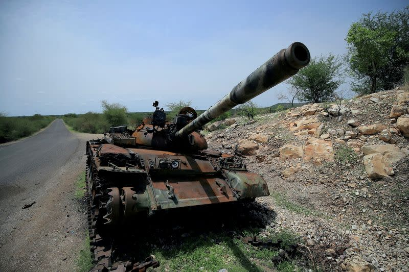 A tank damaged during the fighting between Ethiopia's National Defense Force (ENDF) and Tigray Special Forces stands on the outskirts of Humera town
