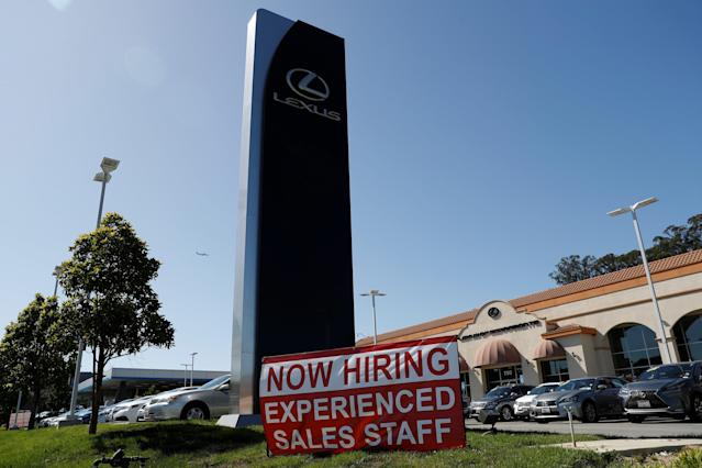 A now hiring sign is seen outside Lexus of Serramonte in Colma, California, U.S., October 3, 2017. REUTERS/Stephen Lam