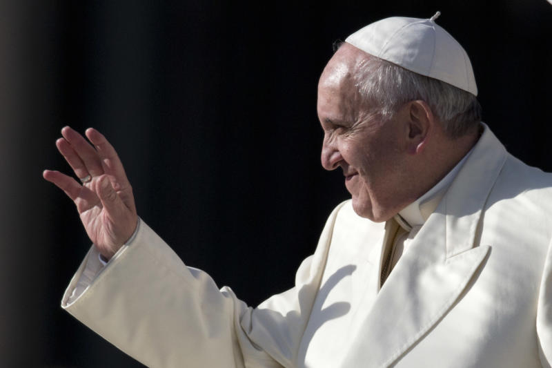 Pope Francis waves as he leaves at the end of his weekly general audience, in St. Peter's Square, at the Vatican, Wednesday, Jan. 15, 2014. (AP Photo/Andrew Medichini)