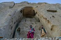 The Taliban destroyed two giant Buddha statues in Bamiyan in 2001, using dynamite and artillery (AFP/BULENT KILIC)