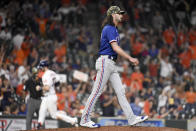 Texas Rangers relief pitcher Hunter Wood, right, walks off the mound as Houston Astros' Kyle Tucker, back left, rounds the bases after hitting a two-run home run during the seventh inning of a baseball game, Saturday, May 15, 2021, in Houston. (AP Photo/Eric Christian Smith)