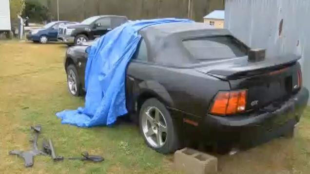 While working on his car, Allen Clemmons of South Carolina got trapped beneath it. (Screenshot: WIS TV)