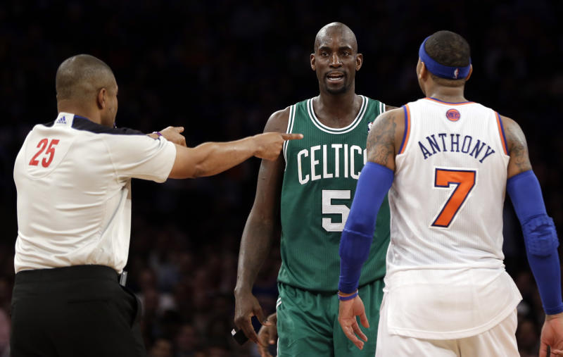 """In this photo taken Monday, Jan. 7, 2013, referee Tony Brothers, left, issues technical fouls to New York Knicks' Carmelo Anthony and Boston Celtics' Kevin Garnett during the second half of an NBA basketball game at Madison Square Garden in New York. The All-Star forwards exchanged words during the game and Anthony clearly was affected. He said Tuesday he lost his cool after Garnett said things to him that he feels shouldn't be said to """"another man.""""  (AP Photo/Kathy Willens)"""