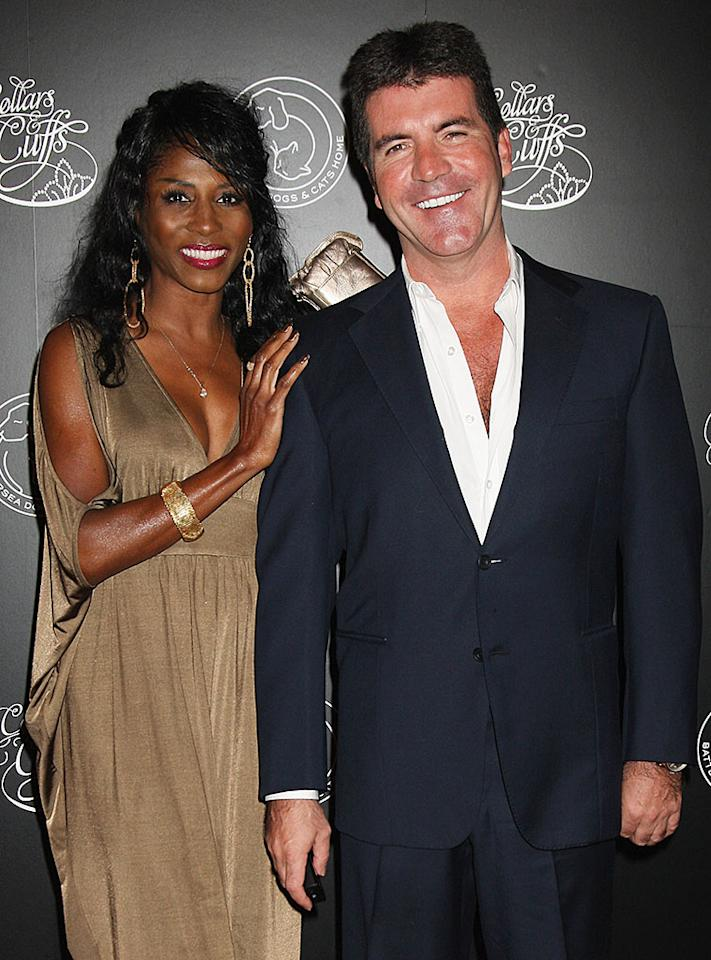 LONDON, ENGLAND - SEPTEMBER 17: Simon Cowell and Sinitta arrive for the Collars and Cuffs Ball at the Royal Opera House on September 17, 2009 in London, England.  (Photo by Chris Jackson/Getty Images) *** Local Caption *** Simon Cowell;Sinitta