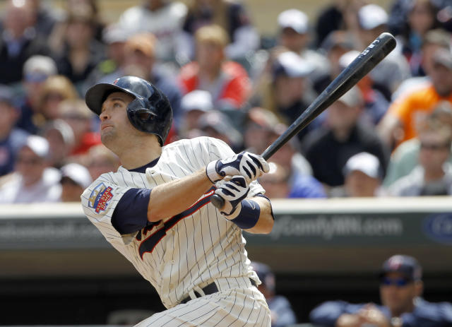 Minnesota Twins' Brian Dozier watches the flight of his solo home run off Baltimore Orioles starting pitcher Wei-Yin Chen during the third inning of a baseball game in Minneapolis, Saturday, May 3, 2014. (AP Photo/Ann Heisenfelt)