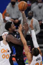 New York Knicks forward Julius Randle (30) goes up for a shot with Orlando Magic center Khem Birch (24) and Magic forward Aaron Gordon (00) defending during the first half of an NBA basketball game, Monday, Jan. 18, 2021, in New York. (AP Photo/Kathy Willens, Pool)