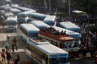 Migrant workers travel in crowded buses as they return to their villages, during a 21-day nationwide lockdown to limit the spreading of coronavirus disease (COVID-19), in Ghaziabad,