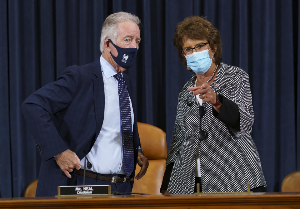 House Ways and Means Committee Chairman Richard Neal, D-Mass., left, confers with Rep. Jackie Walorski, R-Ind., as he presides over a markup hearing to craft the Democrats' Build Back Better Act, massive legislation that is a cornerstone of President Joe Biden's domestic agenda, at the Capitol in Washington, Thursday, Sept. 9, 2021. The high cost of the bill, to help families and combat climate change, would be financed in part by increasing taxes on the wealthy and corporations. (AP Photo/J. Scott Applewhite)