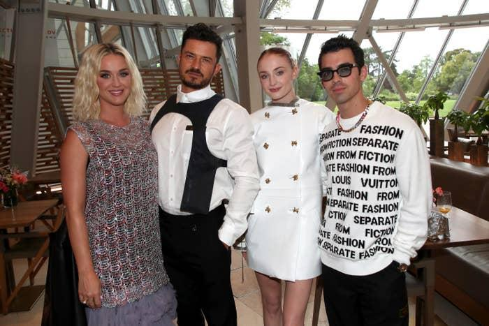 Katy Perry, Orlando Bloom, Sophie Turner, and Joe Jonas are photographed together at a Louis Vuitton event in Paris