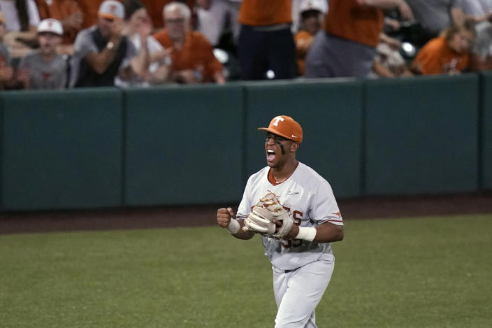 Texas' Camryn Williams reacts after an out against South Florida during the fourth inning of an NCAA Super Regional college baseball game, Sunday, June 13, 2021, in Austin, Texas. (AP Photo/Eric Gay)