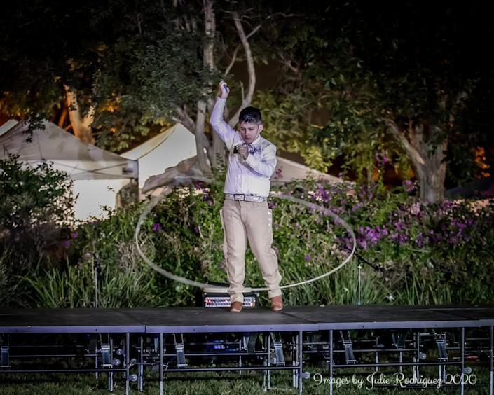 """A student from Thee Academy performs floreo de soga, or traditional rope tricks. <span class=""""copyright"""">( Julie Rodriguez)</span>"""