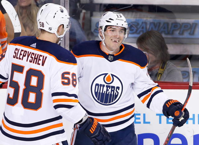 Edmonton Oilers' Michael Cammalleri (13) celebrates his goal with teammate Anton Slepyshev, of Russia, during second period NHL action against the Calgary Flames, in Calgary on Saturday, March 31, 2018. (Larry MacDougal/The Canadian Press via AP)