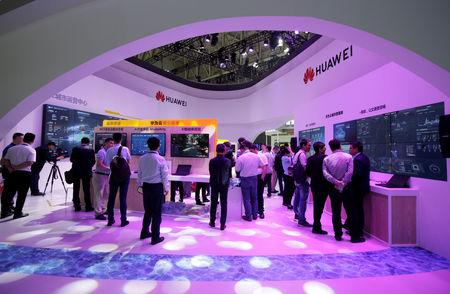 People visit Huawei's booth at an exhibition during the World Intelligence Congress in Tianjin, China May 16, 2019. REUTERS/Jason Lee
