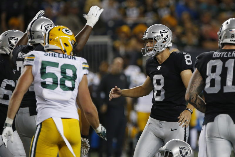Oakland Raiders' Daniel Carlson (8) celebrates his go-ahead field goal against the Green Bay Packers during the second half of an NFL preseason football game Thursday, Aug. 22, 2019, in Winnipeg, Manitoba. (John Woods/The Canadian Press via AP)