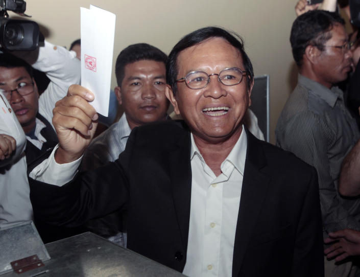 FILE - In this June 4, 2017, file photo, then opposition Cambodia National Rescue Party President Kem Sokha shows off his ballot before voting in local elections in Chak Angre Leu on the outskirts of Phnom Penh, Cambodia. A Cambodian government spokesman says Kem Sokha who has been held been for a year on a treason charge, was released on bail Monday, Sept. 10, 2018. (AP Photo/Heng Sinith, File)