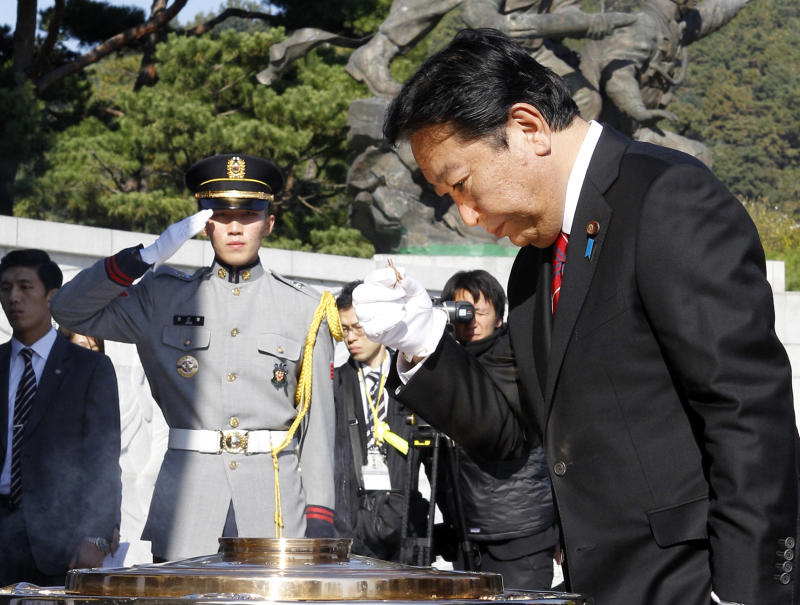 Japanese Prime Minister Yoshihiko Noda burns incense at the National Cemetery in Seoul, South Korea, Wednesday, Oct. 19, 2011. Noda is on the  two-day visit and is scheduled to meet South Korean President Lee Myung-bak Thursday. (AP Photo/Lee Jin-man)