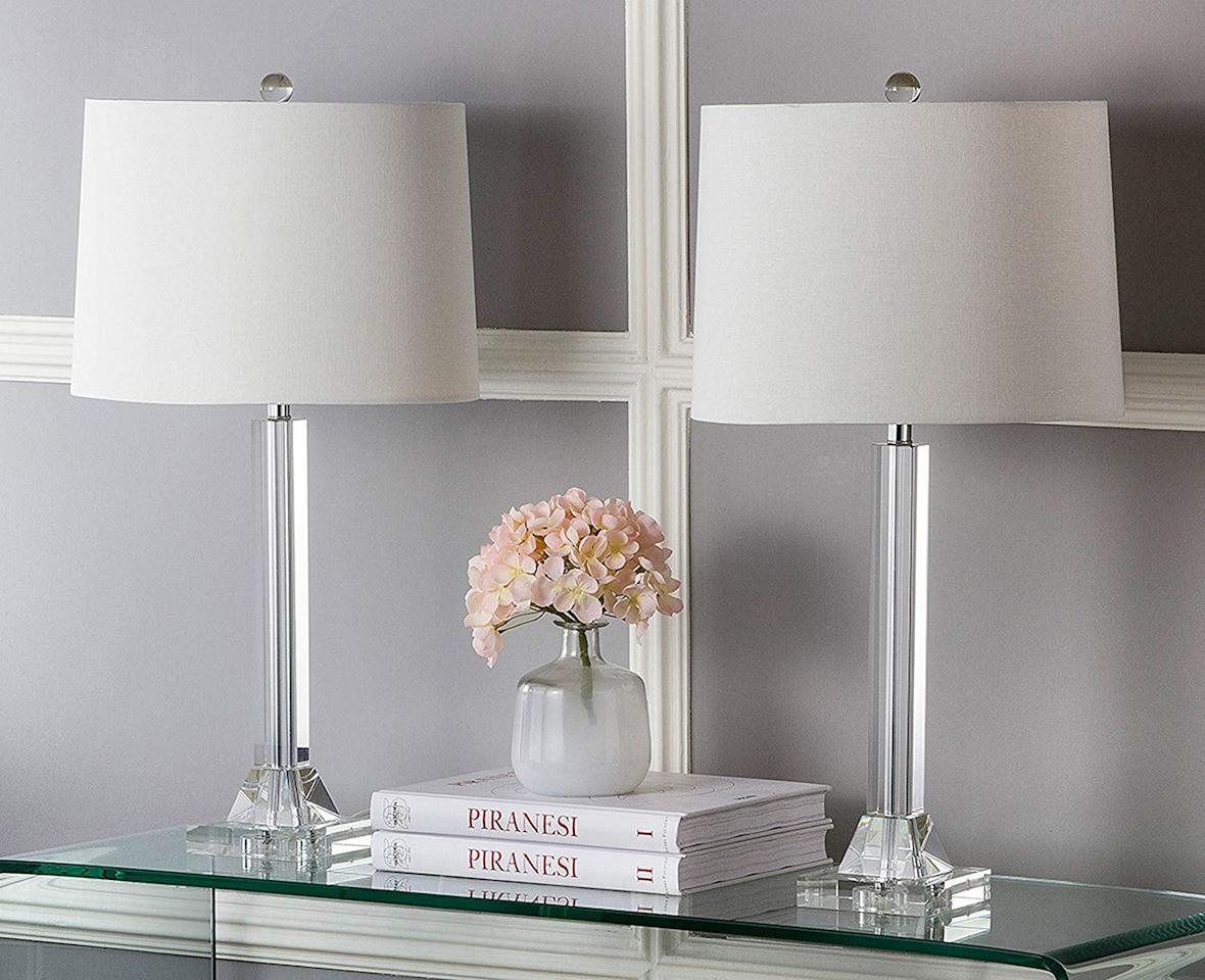 """<p>These pretty <a href=""""https://www.popsugar.com/buy/Safavieh-Lighting-Collection-Tyrone-Crystal-Column-27-inch-Table-Lamp-513039?p_name=Safavieh%20Lighting%20Collection%20Tyrone%20Crystal%20Column%2027-inch%20Table%20Lamp&retailer=amazon.com&pid=513039&price=139&evar1=savvy%3Aus&evar9=46862798&evar98=https%3A%2F%2Fwww.popsugar.com%2Fsmart-living%2Fphoto-gallery%2F46862798%2Fimage%2F46862805%2FSafavieh-Lighting-Collection-Tyrone-Crystal-Column-27-inch-Table-Lamp&list1=shopping%2Camazon%2Csale%2Cblack%20friday%2Ccyber%20monday%2Csale%20shopping%2Cblack%20friday%20sales&prop13=api&pdata=1"""" rel=""""nofollow"""" data-shoppable-link=""""1"""" target=""""_blank"""" class=""""ga-track"""" data-ga-category=""""Related"""" data-ga-label=""""https://www.amazon.com/dp/B00HS3O7EM/ref=va_live_carousel?pf_rd_r=G1AFY47ZGZ97Y2H612X3&amp;pf_rd_p=b2cc7c86-5369-4d23-868e-c227c7e9706e&amp;pf_rd_m=ATVPDKIKX0DER&amp;pf_rd_t=Landing&amp;pf_rd_s=merchandised-search-3&amp;pd_rd_i=B00HS3O7EM"""" data-ga-action=""""In-Line Links"""">Safavieh Lighting Collection Tyrone Crystal Column 27-inch Table Lamp</a> ($139, originally $163) will look so great in your home.</p>"""