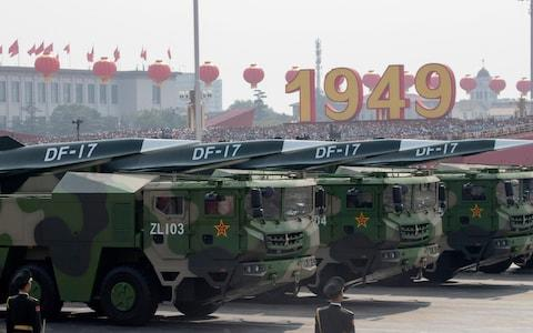 DF-17 missiles parade through Beijing on October 1 - Credit:  Ng Han Guan/AP