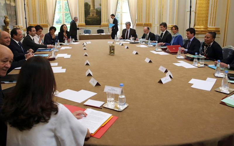 President Hollande chairs a cabinet meeting in the Elysee Palace in 2013.  - Credit: AP