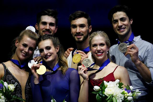 Figure Skating - World Figure Skating Championships - The Mediolanum Forum, Milan, Italy - March 24, 2018 France's Gabriella Papadakis and Guillaume Cizeron pose after winning the gold medal in the Ice Dance with second placed Madison Hubbell and Zachary Donohue of the U.S. and third placed Canada's Kaitlyn Weaver and Andrew Poje REUTERS/Alessandro Garofalo