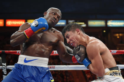 Timothy Bradley, left, connects against Jessie Vargas during their June bout. (AP)